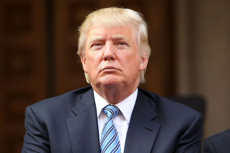 WASHINGTON, DC - JULY 23: Donald Trump listens at the Trump International Hotel Washington, D.C Groundbreaking Ceremony at Old Post Office on July 23, 2014 in Washington, DC. (Photo by Paul Morigi/WireImage)