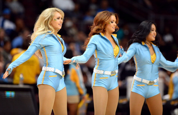 LAS VEGAS, NV - NOVEMBER 29: UCLA Bruins dance team members, including MaCall Manor (L), perform during the team's game against the Northwestern Wildcats during the Continental Tire Las Vegas Invitational at the Orleans Arena on November 29, 2013 in Las Vegas, Nevada. UCLA won 95-79. (Photo by Ethan Miller/Getty Images)